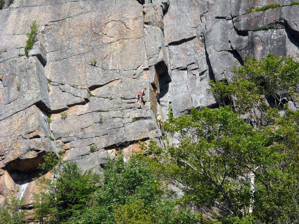 Rock climbers on Pitchoff cliff