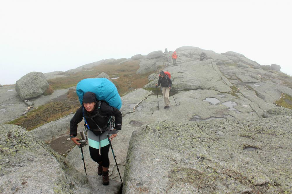 Summer on a High Peak summit can mean pants and windbreakers. Be prepared!