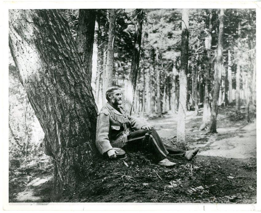 Van Hoevenberg at base of tree c. 1900-1905