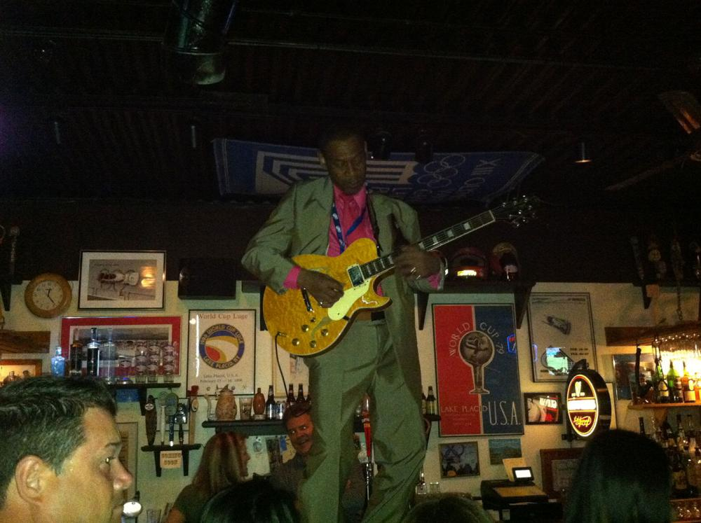 George Boone playing on bar at Zig Zags
