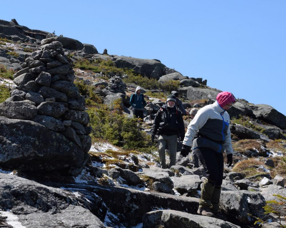 Hikers descend Algonquin's steep summit cone.