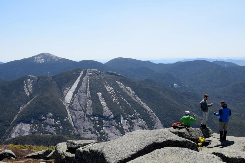 Hikers flock to the summit of Algonquin Peak.