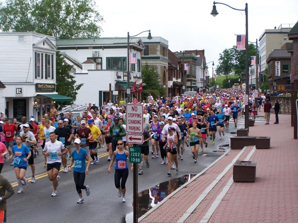 Runners in the Lake Placid Marathon engulf Main Street at the beginning of the race