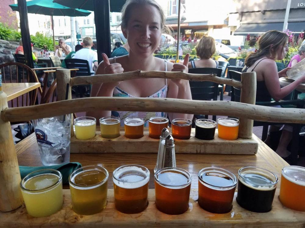 My cousin, Molly, excited to try her beer flight!