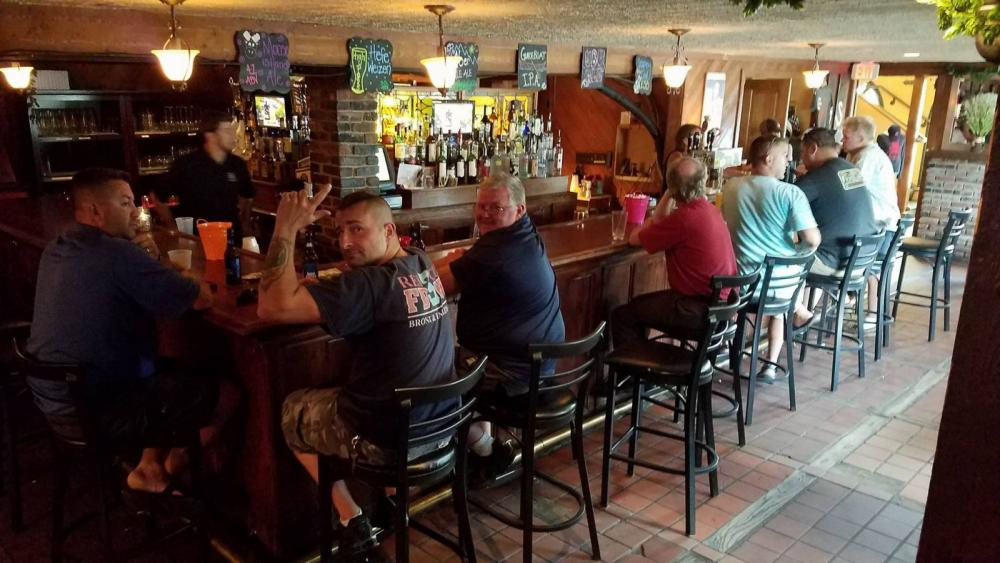 Locals and visitors enjoy happy hour in the legendary PJ O'Neills!