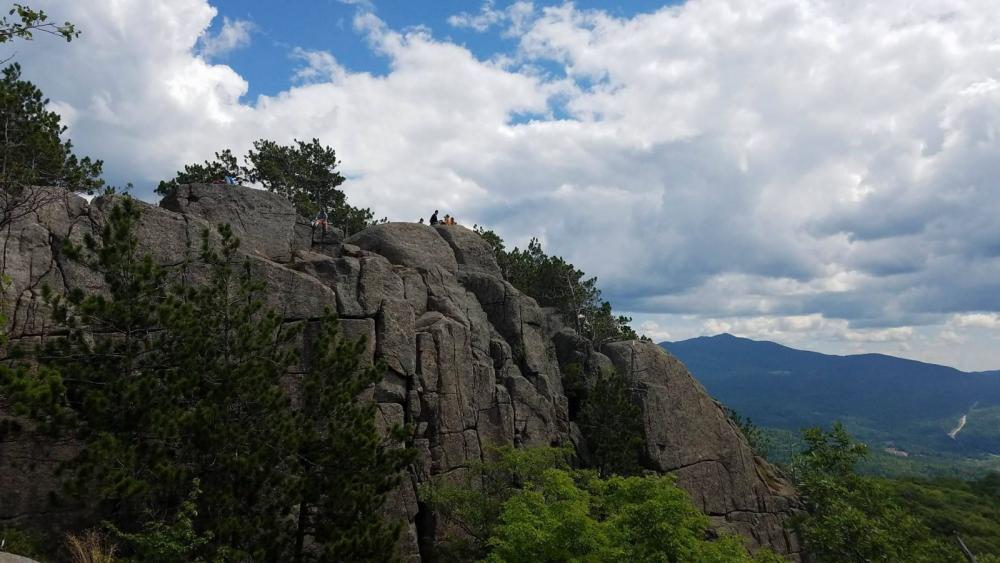 View of the rock wall and summit from a lower lookout!