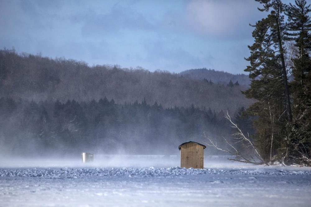 A couple of ice shanties on Lake Colby.