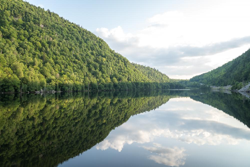 The peaceful reflective waters of the Cascade Lakes.