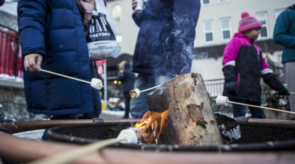 Close-up of roasting marshmallows on a firepit downtown.