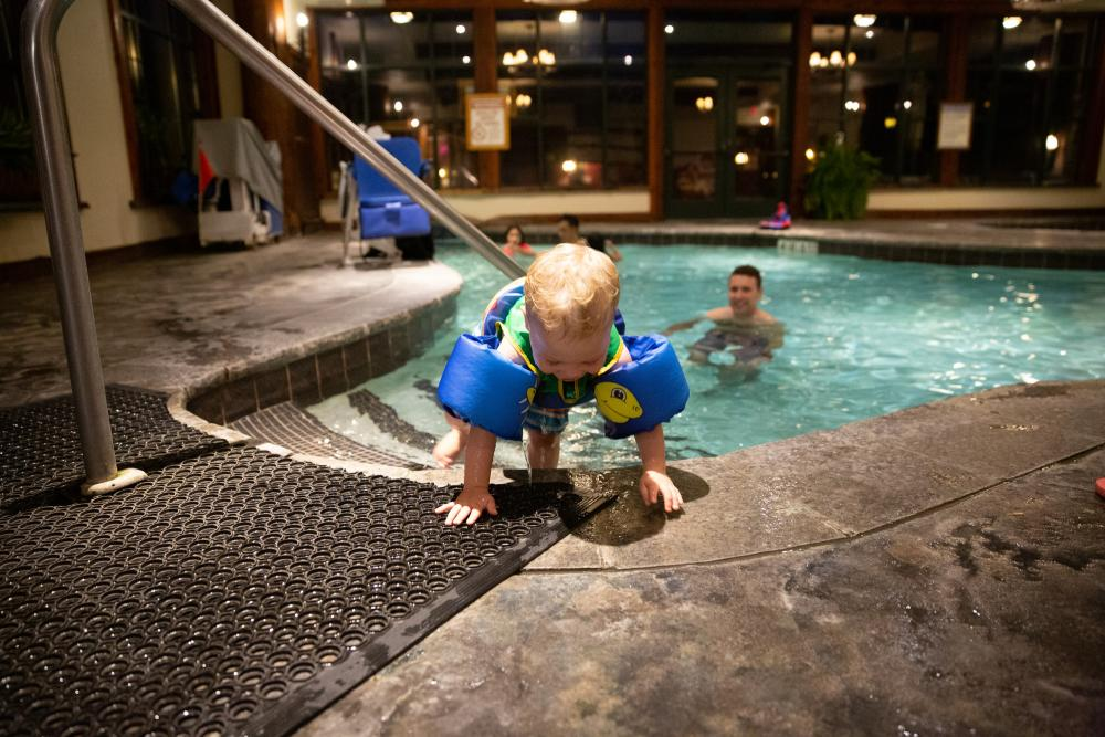 A family enjoys a small indoor pool in Lake Placid.
