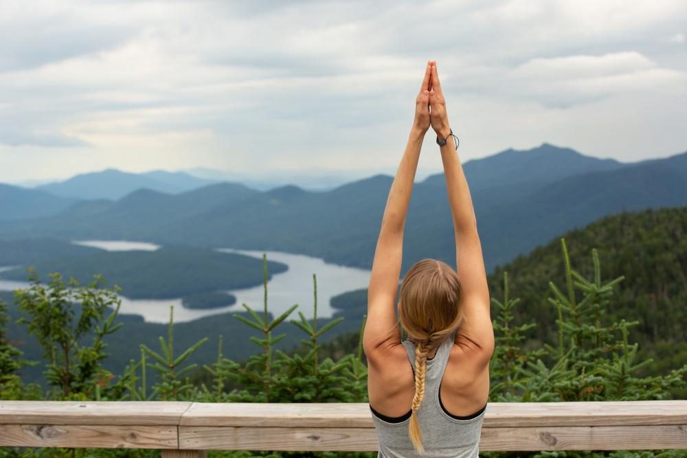 A woman doing yoga on Whiteface Mountain.