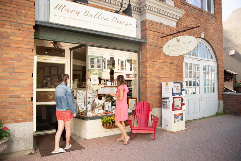 Two women browse Lake Placid's Main Street in the summer.