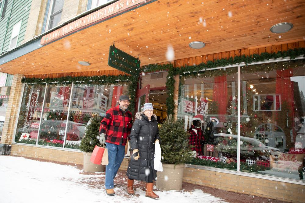 A man and woman shop Main Street on a snowy day.
