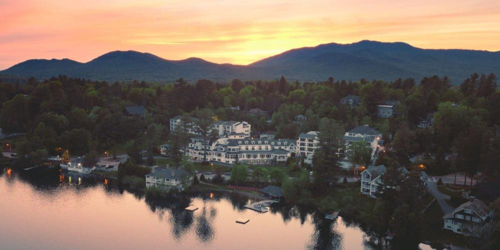 Wide aerial view of the Mirror Lake Inn's numerous buildings overlooking Mirror Lake. Image courtesy Mirror Lake Inn.