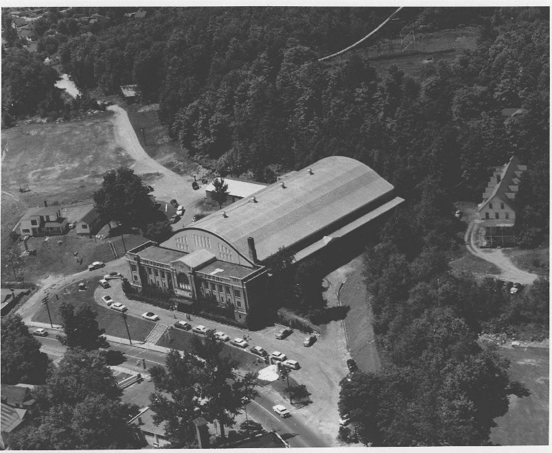 A black and white aerial view of the 1932 Olympic arena, circa 1950. Image courtesy Lake Placid Public Library.
