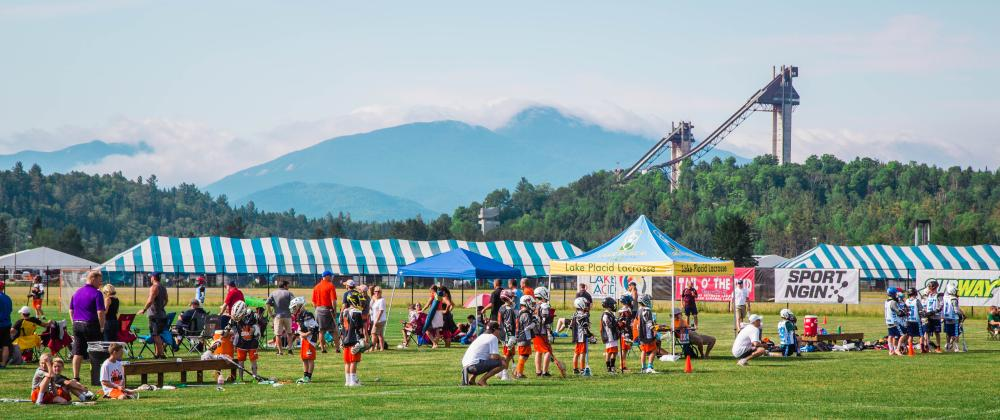 The Olympic ski jumps are seen in the background from a lacrosse tournament