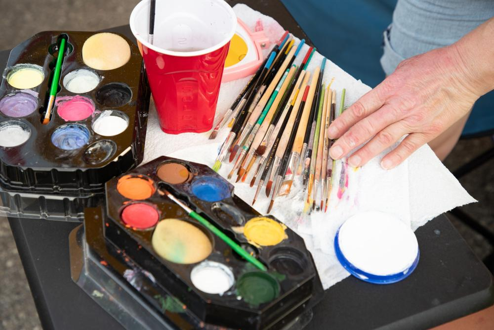 Colorful paints and brushes for an artist getting ready to work.