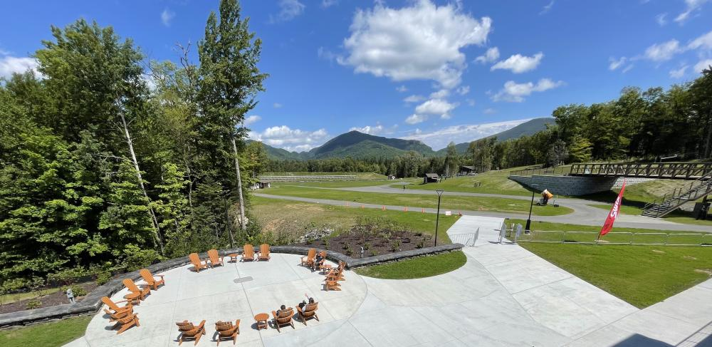 Relax in a circle of Adirondack Chairs outside with High Peak views.