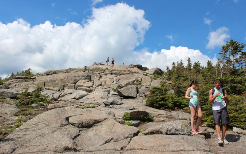 Hikers make their way down Cascade's summit.
